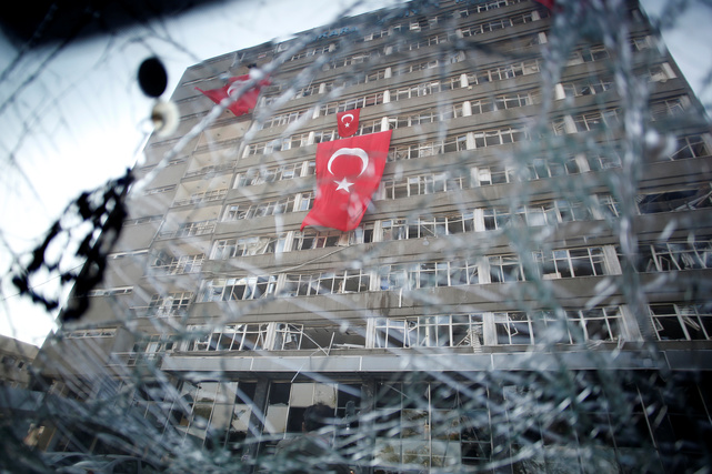 The Ankara police headquarters is seen through a car's broken window caused by fighting during a coup attempt in Turkey, 19 July 2016