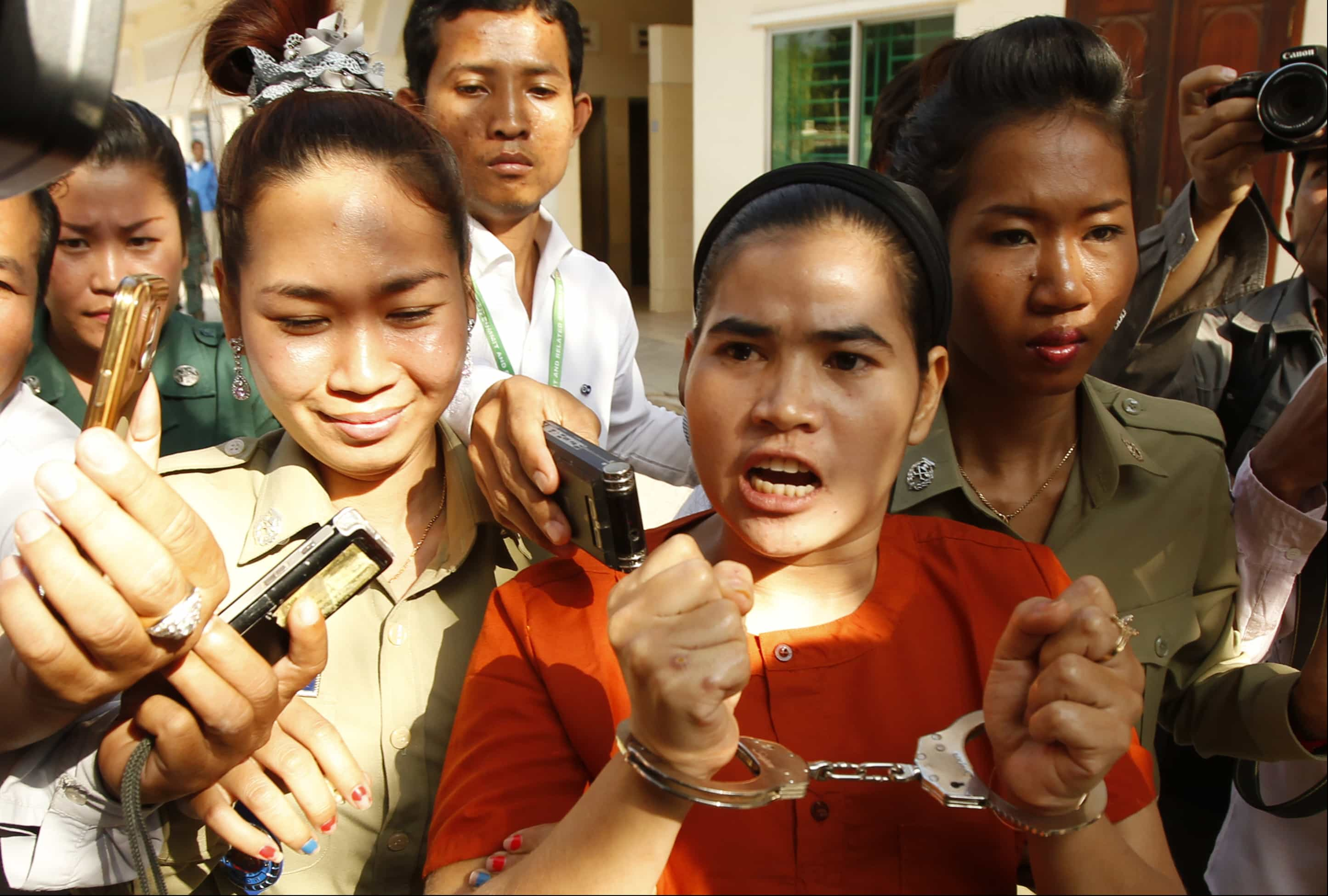 Detained Cambodian land activist, Tep Vanny, center, from the Boeung Kak lake community is escorted by court security during a hearing at Appeals Court in Phnom Penh, Cambodia, Thursday, Jan. 22, 2015., ASSOCIATED PRESS