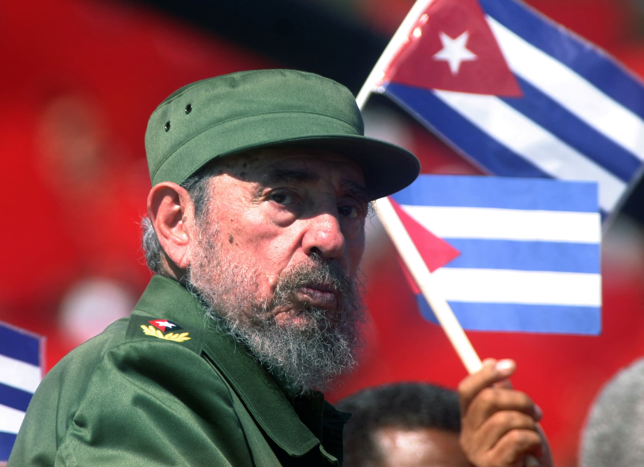 Then Cuban President Fidel Castro glances over his shoulder during the May Day commemoration in 2004, REUTERS/Rafael Perez/Files
