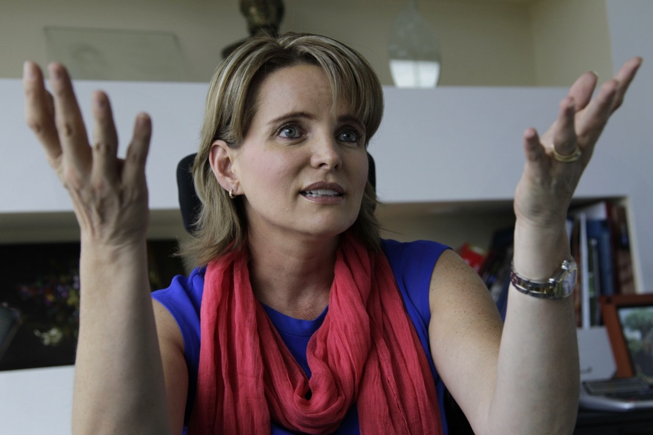 Journalist Janet Hinostroza gestures during an interview at her office in Quito, Ecuador, 13 August 2013, AP Photo/Dolores Ochoa