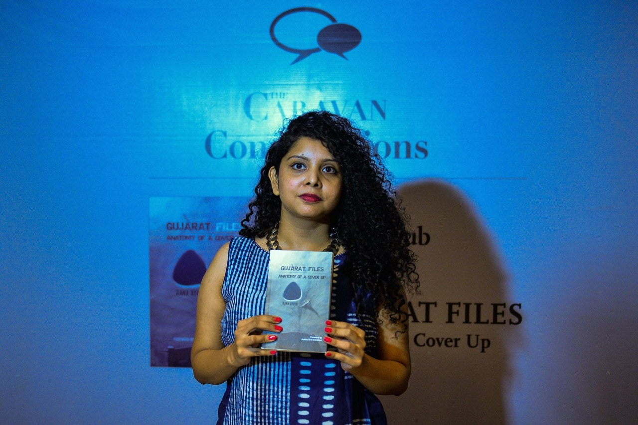 Indian journalist and author Rana Ayyub poses with her self published book 'Gujarat Files' during the launch event in New Delhi, 27 May 2016, CHANDAN KHANNA/AFP/Getty Images