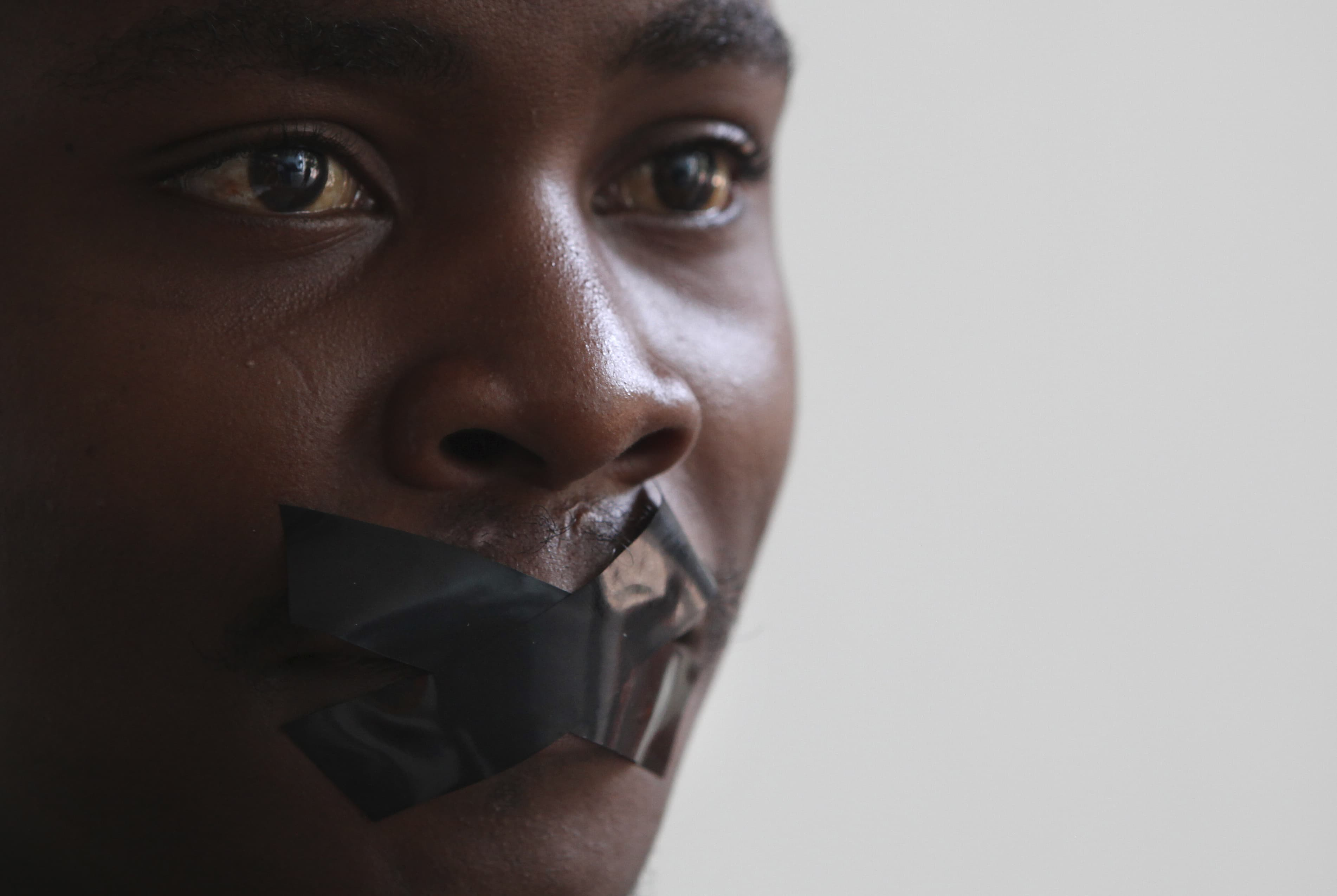 A South African journalist takes part in a 26 February 2014 protest in Johannesburg against the arrest of an Al Jazeera crew in Egypt, AP Photo/Denis Farrell
