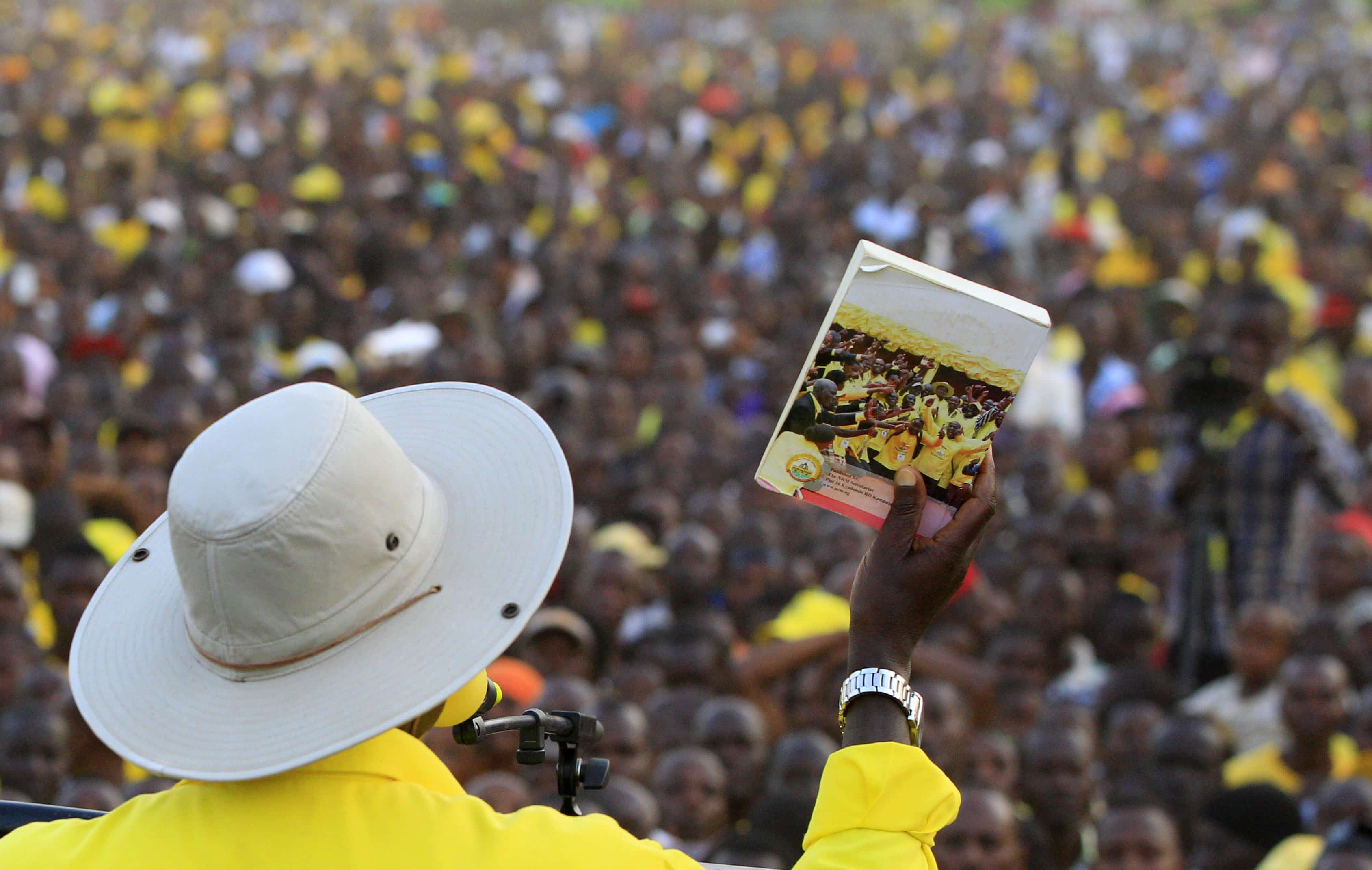Ugandan president Yoweri Museveni shows his manifesto to supporters during a campaign rally in Entebbe, Uganda, 10 February 2016,  REUTERS/James Akena