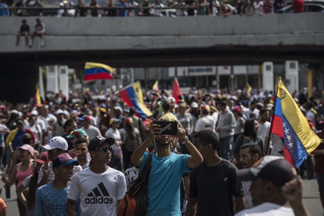 Protesters take part in a massive rally against Maduro's government in Caracas, Venezuela, 2 February 2019, Marcelo Perez Del Carpio/Anadolu Agency/Getty Images