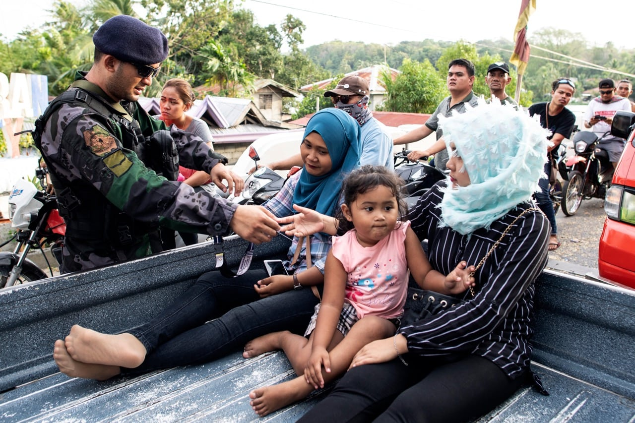 Security forces check identification at a checkpoint in Cotabato on the island of Mindanao, Philippines, 20 January 2019, NOEL CELIS/AFP/Getty Images