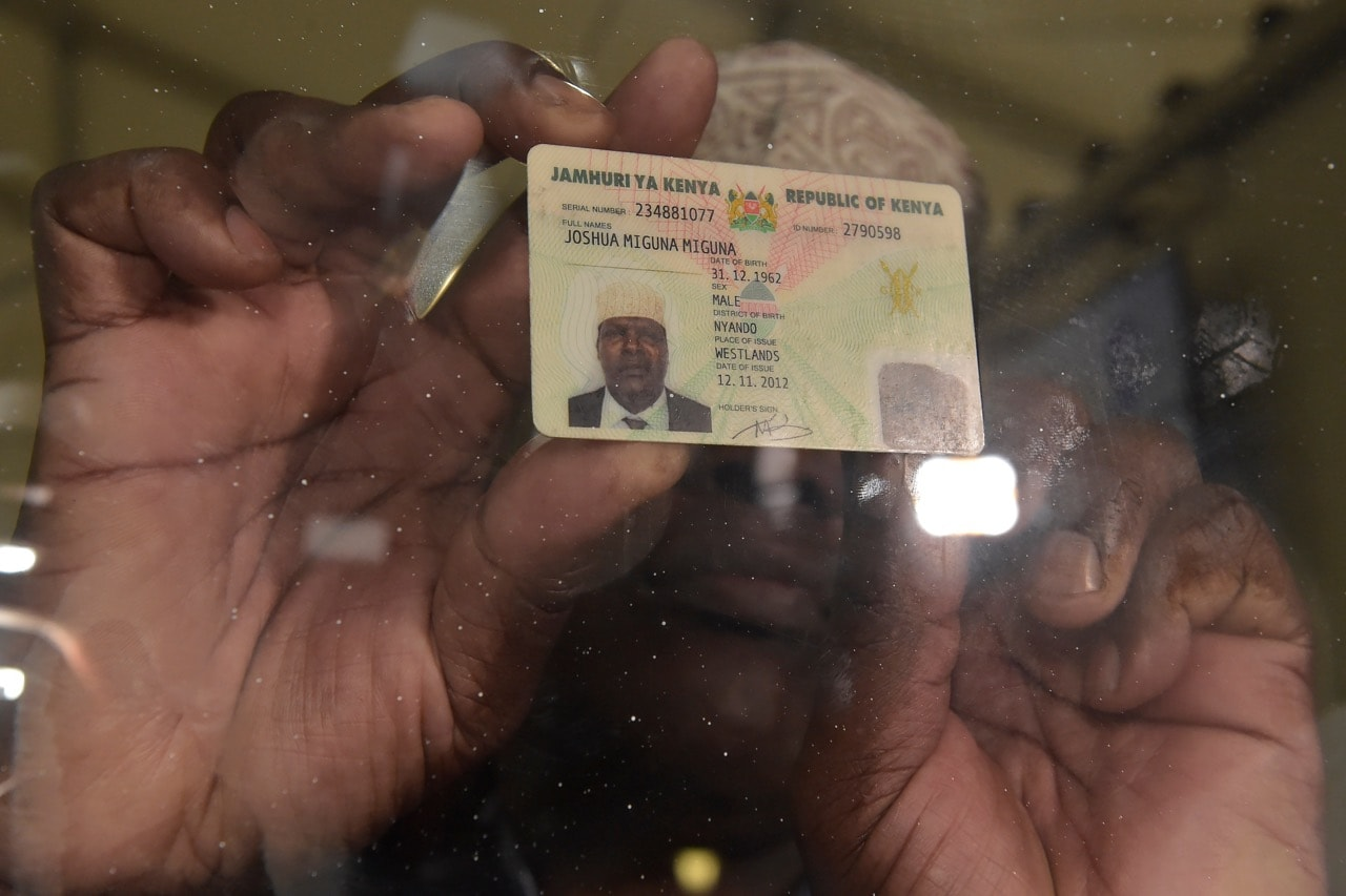 Opposition politician Miguna Miguna shows his Kenyan Identity Card to the media, at the Jomo Kenyatta International Airport (JKIA) in Nairobi, 26 March 2018, SIMON MAINA/AFP/Getty Images