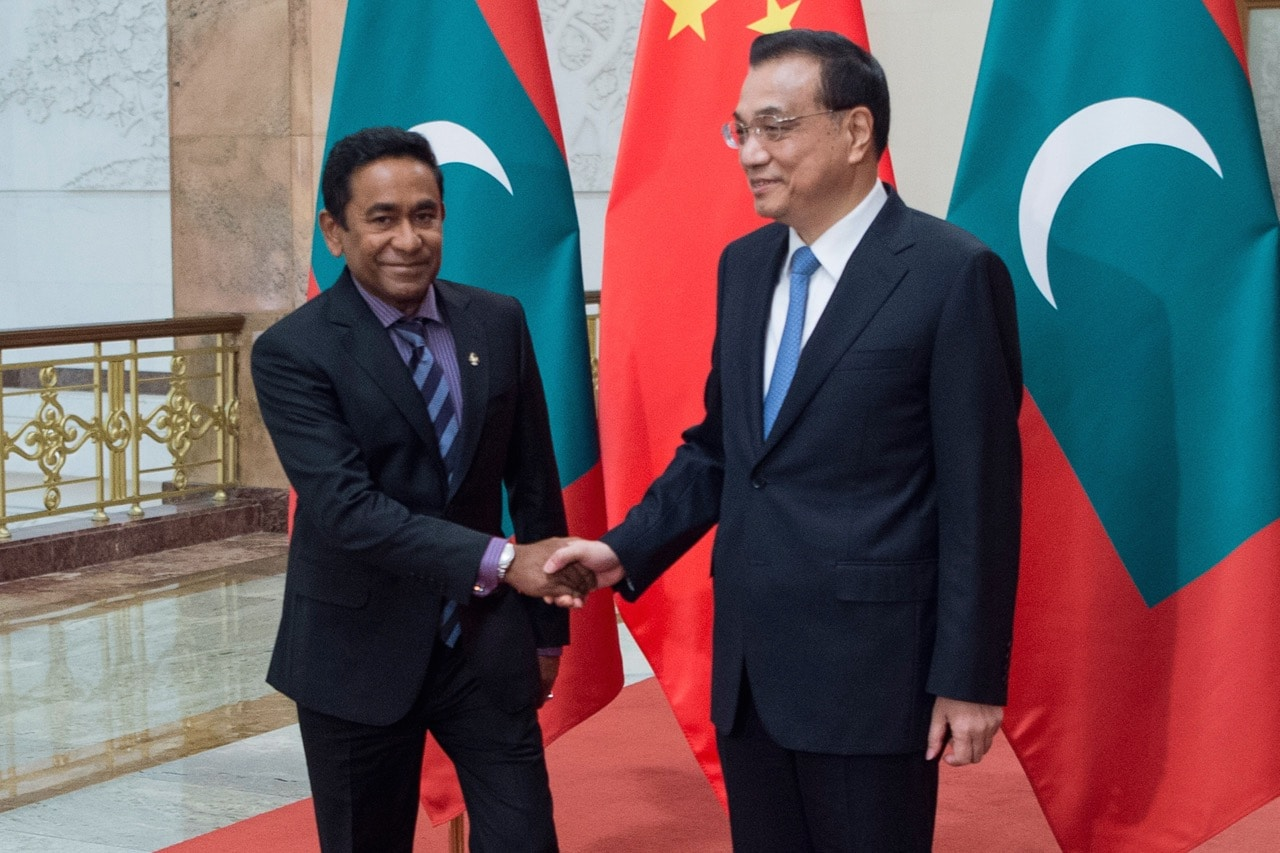 China's Premier Li Keqiang (R) shakes hands with Maldives' President Abdulla Yameen at the Great Hall of the People in Beijing, 7 December 2017, FRED DUFOUR/AFP/Getty Images