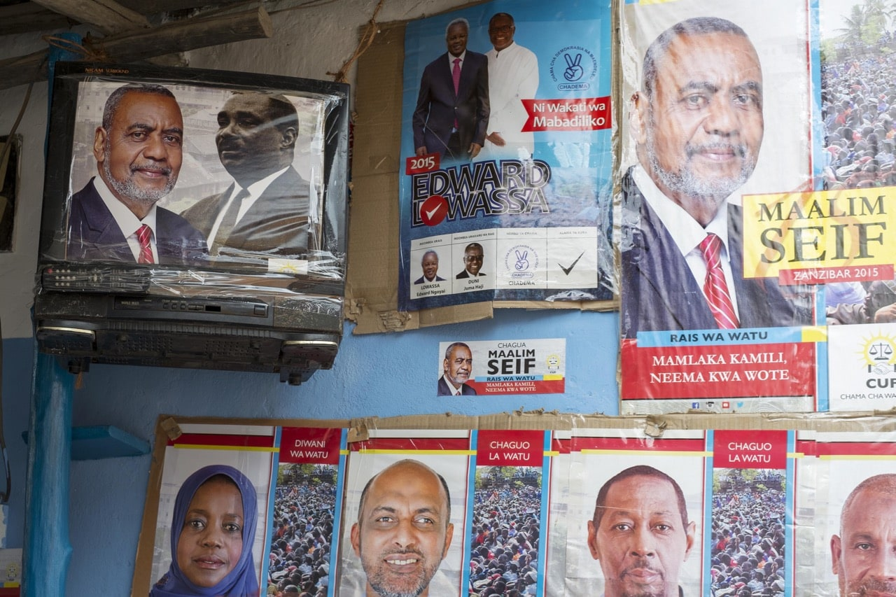 A poster for an opposition party presidential candidate is taped to a television set, in Stone Town, Tanzania, 1 November 2015, Daniel Hayduk/AFP/Getty Images