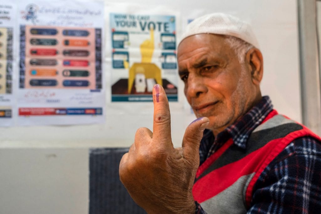 A man shows his finger marked with indelible ink after casting his ballot in Srinagar, Kashmir, India, 18 April 2019, Yawar Nazir/Getty Images