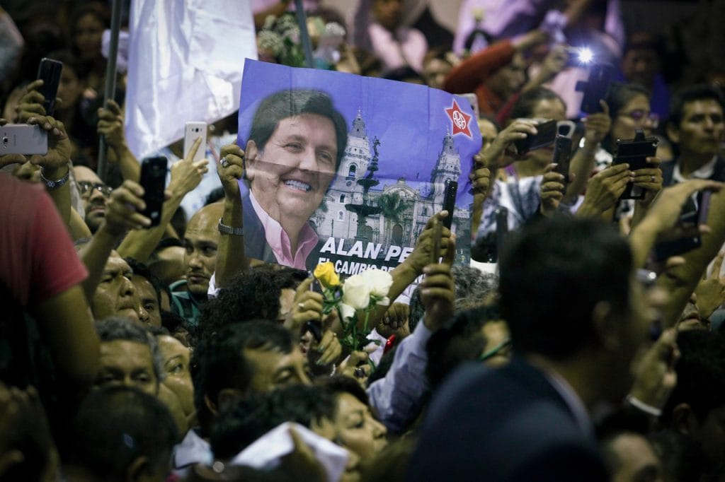 Supporters of former Peruvian President Alan Garcia gather for his funeral at the APRA headquarters in Lima, 17 April 2019, Leonardo Fernandez/Getty Images