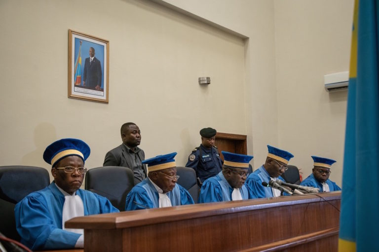 The judges of the Constitutional Court address the court during their pronouncement in a case, Kinshasa, DRCongo, 19 January 2019, CAROLINE THIRION/AFP via Getty Images