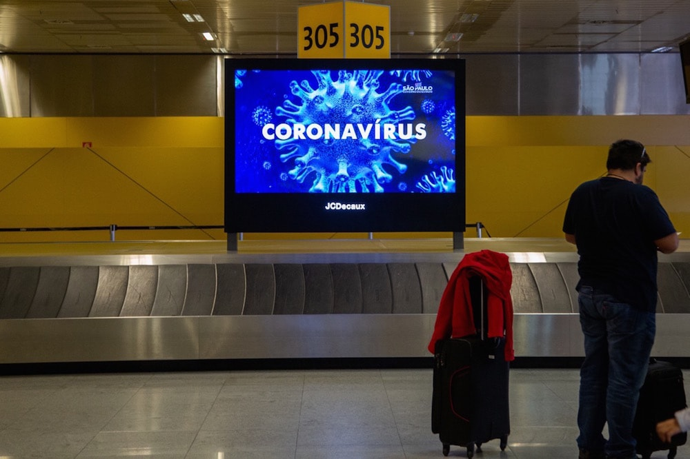 Messages about Covid-19 greet passengers landing at Guarulhos International Airport, São Paulo, Brazil, 15 March 2020, Carol Coelho/Getty Images