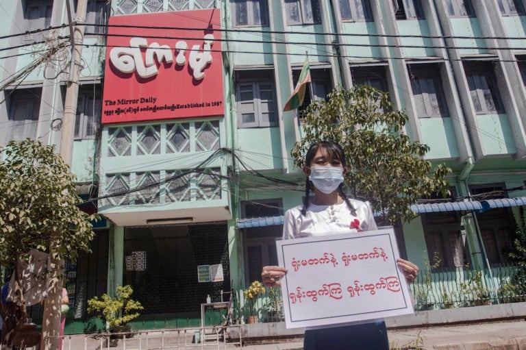 A government newspaper staff member holds a placard as her colleagues take to the streets to protest against the military coup and demand the release of Aung San Suu Kyi, Yangon, Myanmar, 11 February 2021, Santosh Krl/SOPA Images/LightRocket via Getty Images