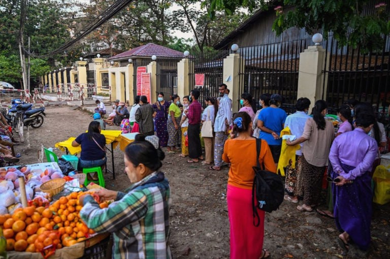 People queue in front of Insein prison in Yangon, Myanmar, 12 April 2021, while they wait to visit inmates ahead of the long holiday stretch for the Myanmar New Year, STR/AFP via Getty Images