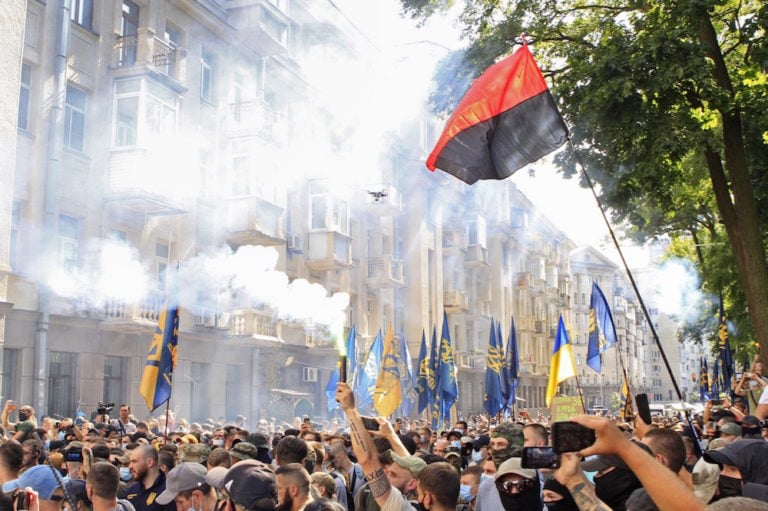 People light flares during a rally by nationalist groups, outside the Office of the President of Ukraine, in Kyiv, 14 August 2021, Anna MarchenkoTASS via Getty Images